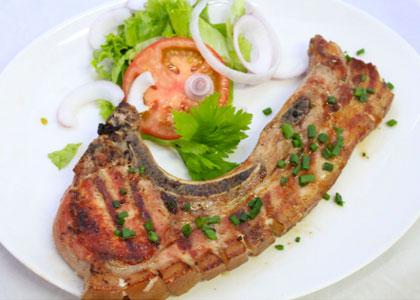 Мясо гриль в ресторане Guachinche El Cordero