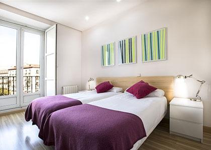 Спальня в Mola Suites